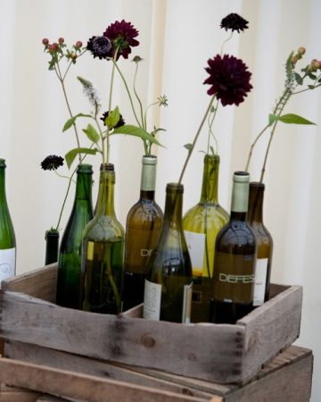 Wine bottle flower centerpieces in refurbished crates