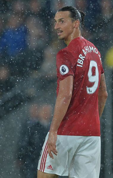 Zlatan Ibrahimovic of Manchester United challenges with Jake Livermore of Hull…