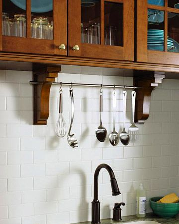 Add a simple and elegant dowel rod above your kitchen sink to keep your utensils always within reach.