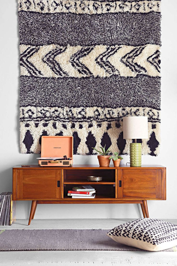 Display Rugs as Wall Art: You don't need to splurge on a woven tapestry to get in on the textural art trend. Try hanging a small rug for a similar effect — you can always recycle it for your floors.