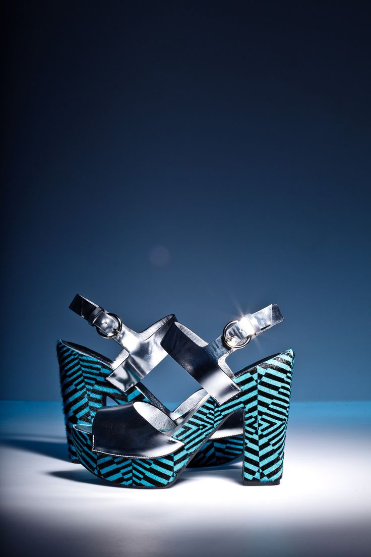 In spotlight: Optical illusions by Pleasemachine high block heel platform sandals featuring mirror leather and hair with geometric electric blue/black print on the platform