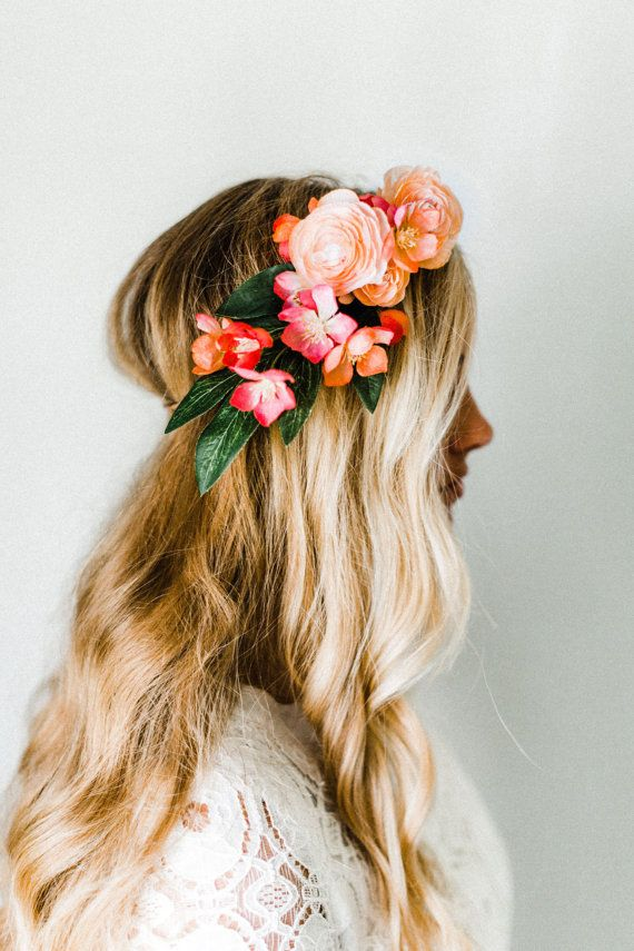 Blush ranunculus + coral-toned blooms swept to the side for a delicate, whimsical look. Made with silk flowers so itll last forever