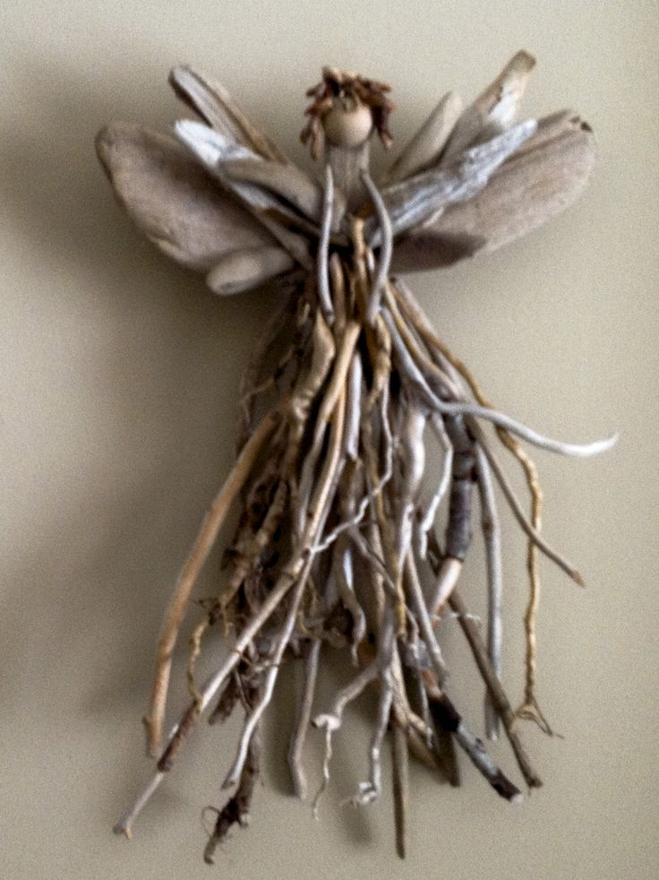 "Lake Superior Driftwood Angel- one of a kind. made from stick and driftwood taken from the shores of Lake Superior, and designed by an artist from upper Michigan 14""H x 16"" W  $40.00"