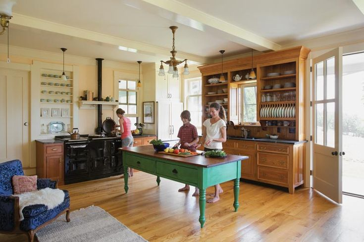 Kathy and her children can often be found in the kitchen, which is outfitted with an AGA stove and large worktable. Source: Building an Authentic New Old Farmhouse - Old-House Online - Old-House Online