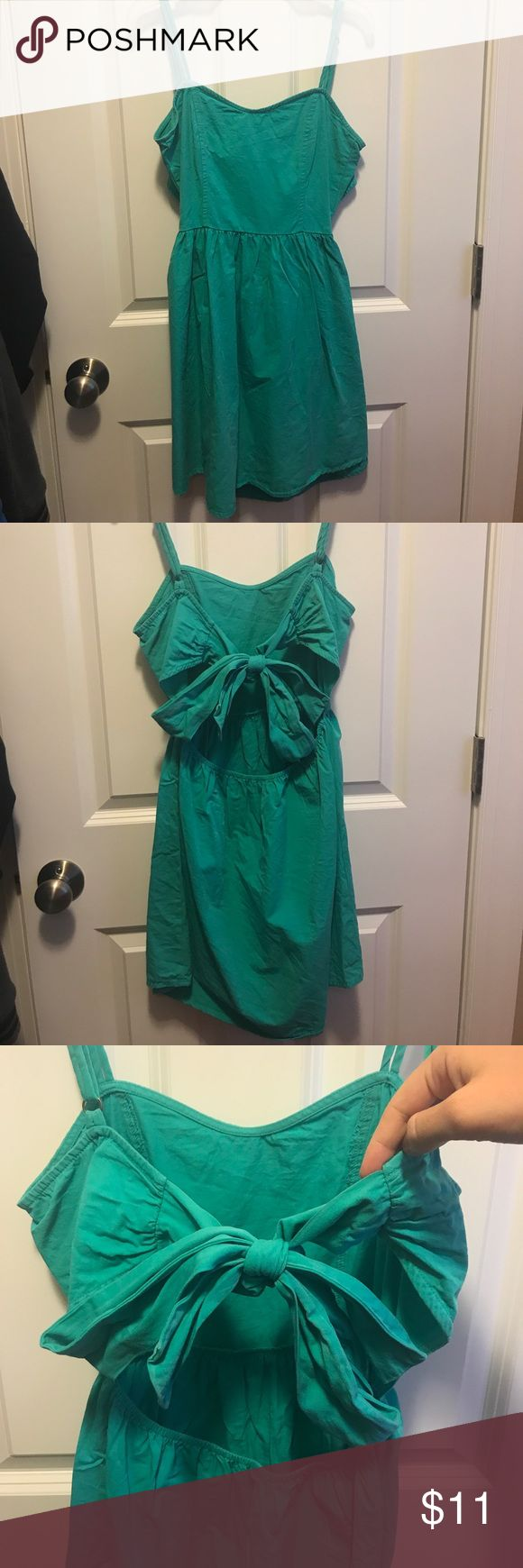 Adorable Turquoise Green Dress w/ detailed back! This dress is perfect for going to a casual wedding, date, or out just about anywhere! You can dress it up by adding a fancy necklace or dress it down by adding a waist belt. It has an open back with parts that you can tie into a bow. Color is a turquoise green color. Worn a couple of times, color isn't faded or anything. Open to counter offers 😊 🚫 no trades 🚫 Dresses