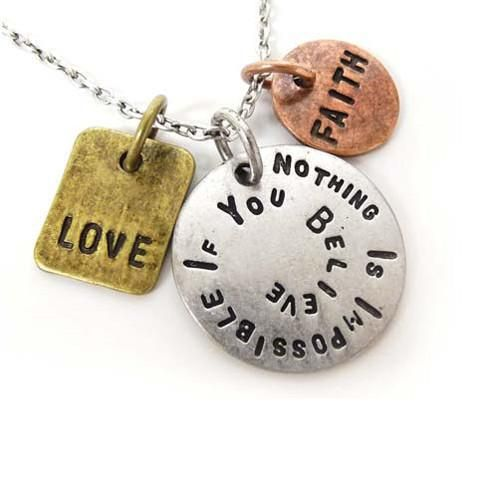 """Inspirational Nothing Is Impossible Necklace. Popular hand-stamped finish, neutral tri toned charms and delicate silver chains make our Stamped With Love necklaces beautiful, eye-catching and adored. Inspirational quotes add to their appeal by delivering uplifting messages. This piece has charms that say love, faith, and """"nothing is impossible if you believe."""" These words encourage us to never lose faith in what we believe in, and that as long as we remain positive and full of love, anything…"""