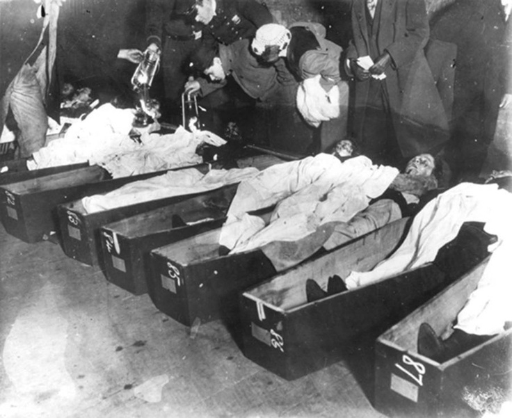 Remembering the Triangle Shirtwaist Fire - Family members and awakens peer at the bodies in the morgue.