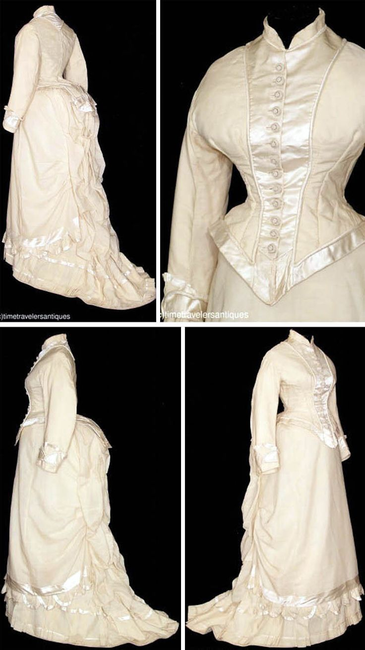 Two-piece ivory silk gown, ca. 1878. Piped and trimmed in silk satin with 13 passementerie buttons as front closure. They repeat at tail. Skirt has pleated and draped waterfall back with train, matching underskirt, pleated satin ruffle on overskirt, and directional & box-pleated hem with piped floor brush. time-travelers/ebay