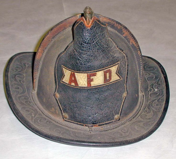Alberni Fire Department helmet, pre-1950. Made of black leather, with a beaver crest on top.   [Alberni Valley Museum Collection 2000.2.1]