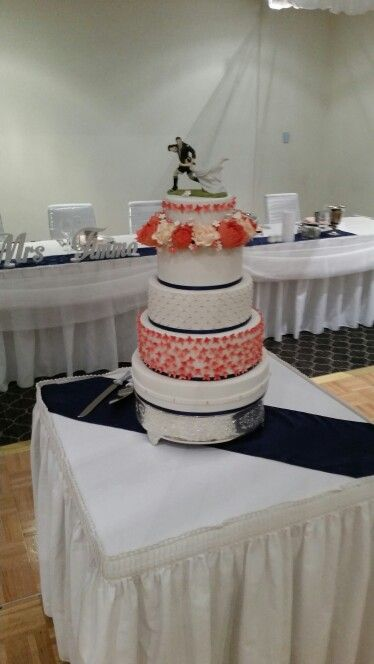 """Coral """"rugby"""" themed cake - made for Nicolene & Thomas."""