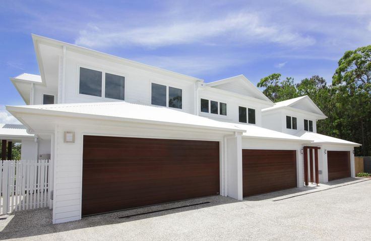Bright white townhouses by Highlife Homes Gold Coast.