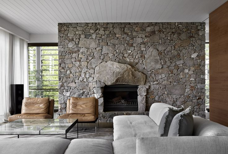 Large stone forms hearth detail for the Meakins Road Residence by B.E Architecture