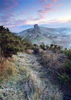 Last years talented winner, Dorset photographer Antony Spencer, captures a scene of frosty dawn colours in a ?Winter mist at Corfe Castle, Dorset, England.