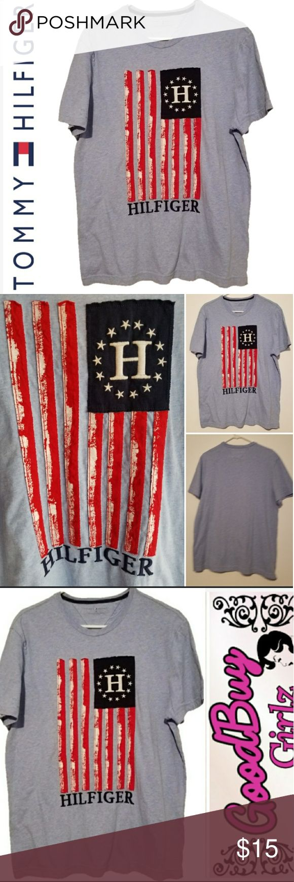"""Tommy Hilfiger Blue Flag Aplique Tee Americana design vertical flag aplique tee in a soft blue color with red white stripes and the """"H"""" surrounded by stars and the Hilfiger name below. Excellent used condition, no rips, holes, tears. Tommy Hilfiger Shirts Tees - Short Sleeve"""