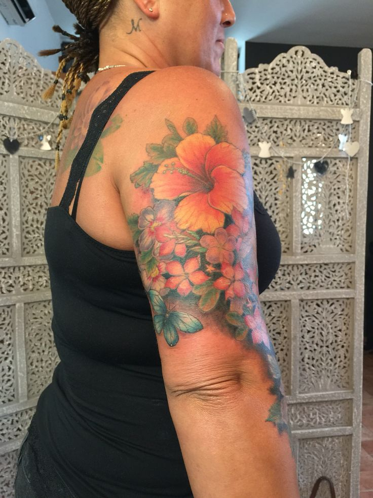 Floral sleeve Kenyan flowers and birds  On very tanned skin