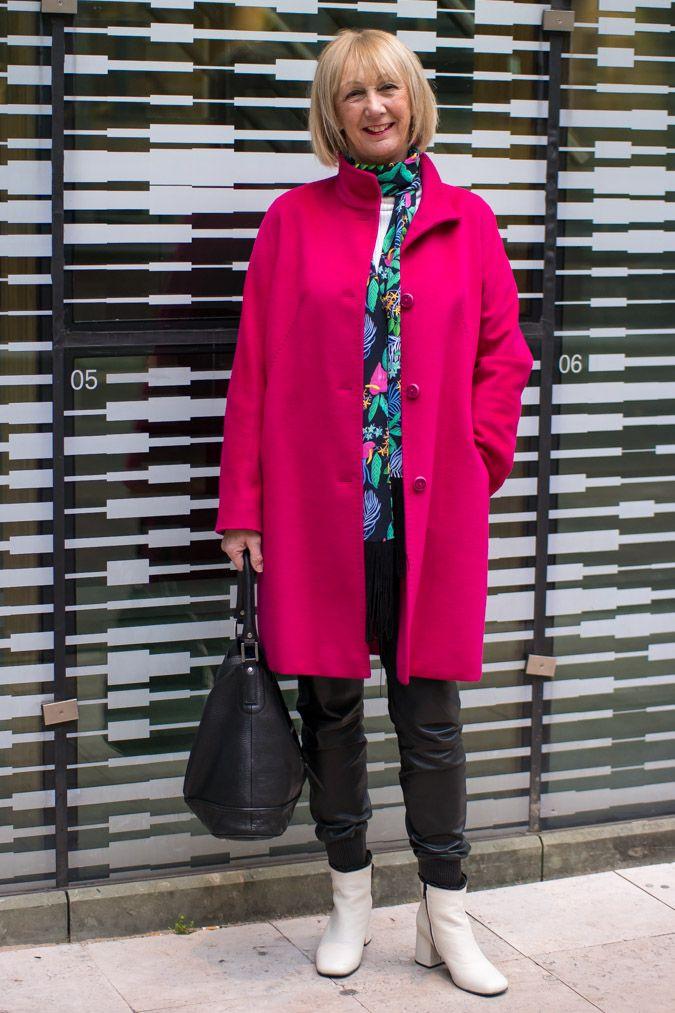 Fuchsia coat by Max Mara, black bag Longchamps, black leather jogging trousers Tony Cohen, long scarf Essentiel Antwerp, cream boots Fly London