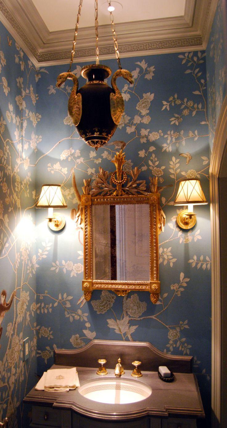 What an elegant powder room! I love the wallpaper …