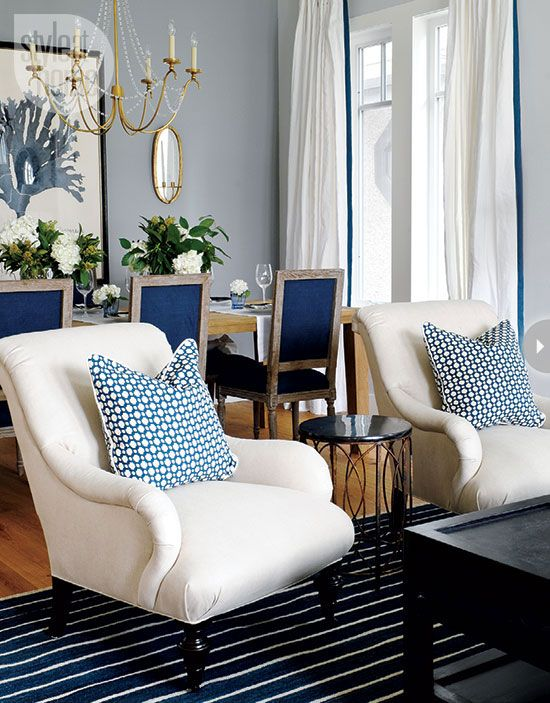Blue and white living/dining room.  Gold accents
