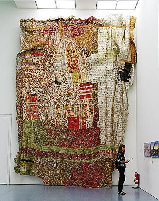 Aaaamazing...bottle caps stitched together with copper wire by El Anatsui
