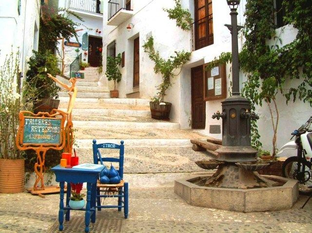 Frigiliana - chairs on steps up the side of this mountain village