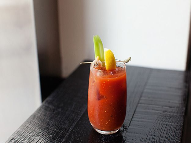 This concept of adding clam juice to make a brinier Bloody Mary originated, and still remains popular, in Canada. It's typically made with Clamato juice but at North End Grill they shuck cherry stone clams and mix that fresh clam juice into the drink then skewer the clam right on top of the highball glass. \n