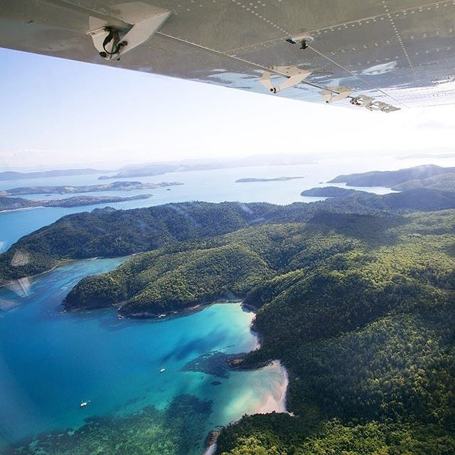 """""""Happy St. Patrick's Day! What better way to celebrate than flying over the Emerald of the Whitsunday Islands and Great Barrier Reef!""""@sailingwhitsundays"""
