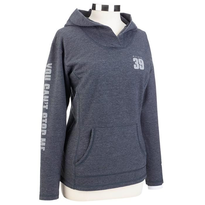 You can't be stopped in this AVON 39 power hoodie. This 7 oz. hoodie is heather dark grey with a feminine, semi-fitted silhouette and convenient front pouch pocket. Right sleeve features You Can't Stop Me mantra. Net proceeds go to the Avon Breast Cancer Crusade. Regularly