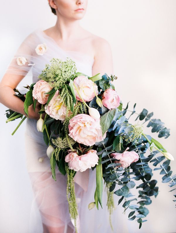 """The kind of wild florals we love at Fearless Authentic.    Have you seen our new online wedding planning course for fearless brides-to-be? In WEDPLANOLOGY We teach everything you need to know about planning a stylish and authentic wedding.    """"The size of the bouquet offset the softness of its blooms and gave it grandeur,"""" Phuong says. """"I wanted to go beyond the traditional norms of wedding floral design and show brides the beauty of something different."""" 