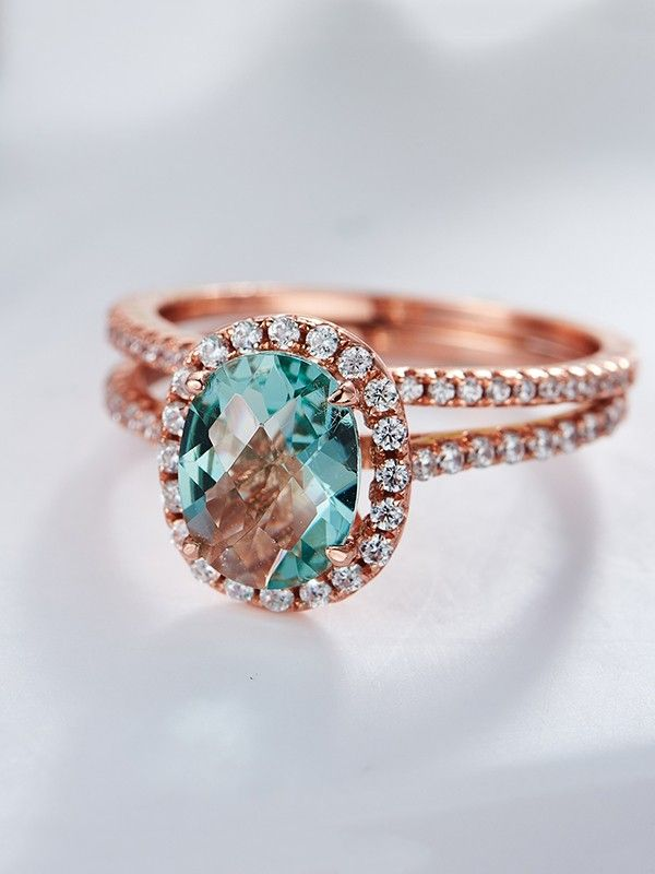 [ad] To match the precious love you two share, ask the big quesiton with the Auquamarne Engagment Rings set.