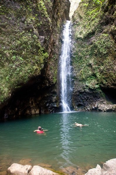 Sacred Falls, Oahu Hawaii. I made the 5 mile round trip hike and jumped off the side and swam here a couple years before the landslide that killed 7 people.