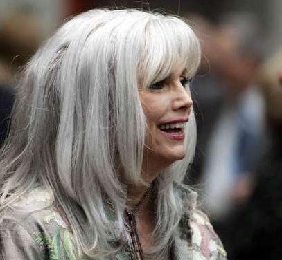 Emmylou Harris, at 65 (I think). She may have gotten older, but she doesn't seem to have let that change her style.