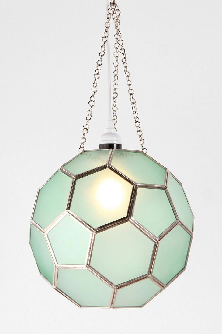 Honeycomb Glass Pendant Shade from Urban Outfitters.    This would even look gorgeous with some natural light shining through.