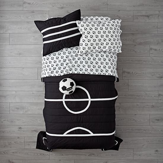 The Land of Nod Soccer Bedding is so great, it's ready to go pro. Made from comfy 100% cotton, the quilt is uniquely designed to resemble a soccer field. And the printed sheet set is made from 100% organic cotton.