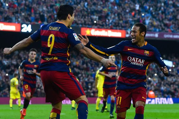 Luis Suarez of FC Barcelona celebrates with his team mate Neymar of FC Barcelona after scoring his team's second goal from the penalty spot during the La Liga match between FC Barcelona and Villarreal CF at Camp Nou on November 8, 2015 in Barcelona, Catalonia.
