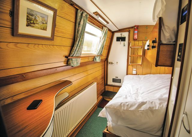 The rear cabin of one of our Wild Burdock class holiday hire boats - space and comfort with a fixed double berth #narrowboat www.calcuttboats.com