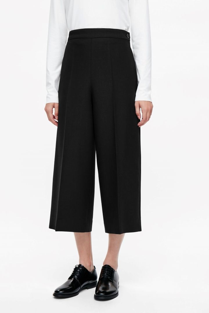 COS image 2 of Wide-leg trousers with side button in Black