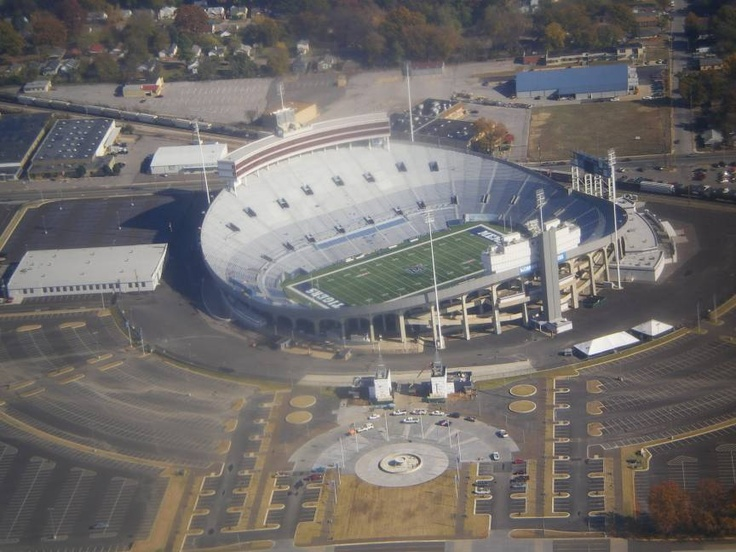 University of Memphis Tigers. Low aerial view. Liberty Bowl Memorial Stadium (originally Memphis Memorial Stadium) is a football stadium, located at the Mid-South Fairgrounds, in Midtown Memphis, Tennessee, United States. The stadium is the site of the annual AutoZone Liberty Bowl, and is the home field of the University of Memphis Tigers football team.