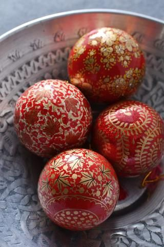 Four hand-painted baubles: Red and Gold- from Decorator's Notebook Shop (they ship to UK, Europe and USA)