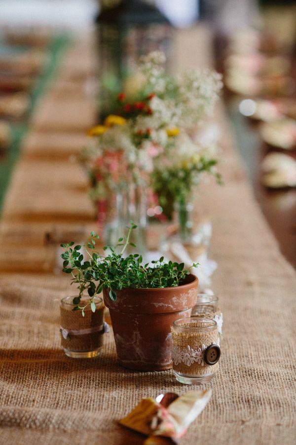 organic table decor with burlap and greenery #weddingreception #tabledecor #weddingchicks http://www.weddingchicks.com/2014/01/30/time-travel-wedding/