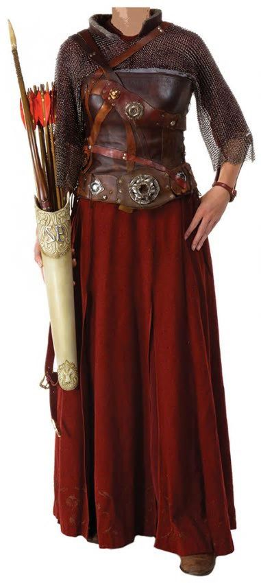 Susan Pevensie final battle costume from The Chronicles of Narnia Prince Caspian. Brown/reddish molded leather corset with resin ornamentation, red leather gauntlet with cream resin ornamentation, wine red silk under-skirt with matching cotton blouse and wool skirt with gold printing at bottom. Chainmail top with leather edging.