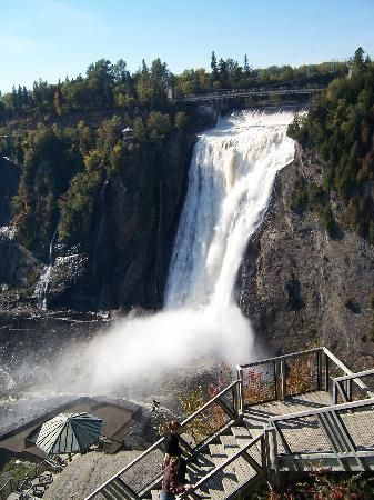"""Quebec City, QC - Montmorency Falls Park (Parc de la Chute-Montmorency). """"These 275-foot falls on the Montmorency River tower higher than even the legendary Niagara Falls."""""""