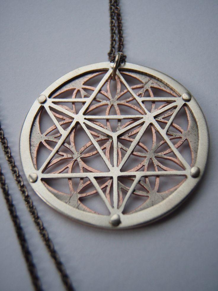 La estrella tetraedro y flor de la vida colgante Plata y
