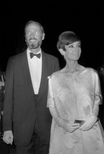 The actress Audrey Hepburn photographed with her husband Mel Ferrer (actor, dialogue coach and film director) by Jacques Marqueton at the Théâtre Marigny, located at the corner of Avenue des Champs-Élysées and Avenue Marigny, in the 8e arrondissement...