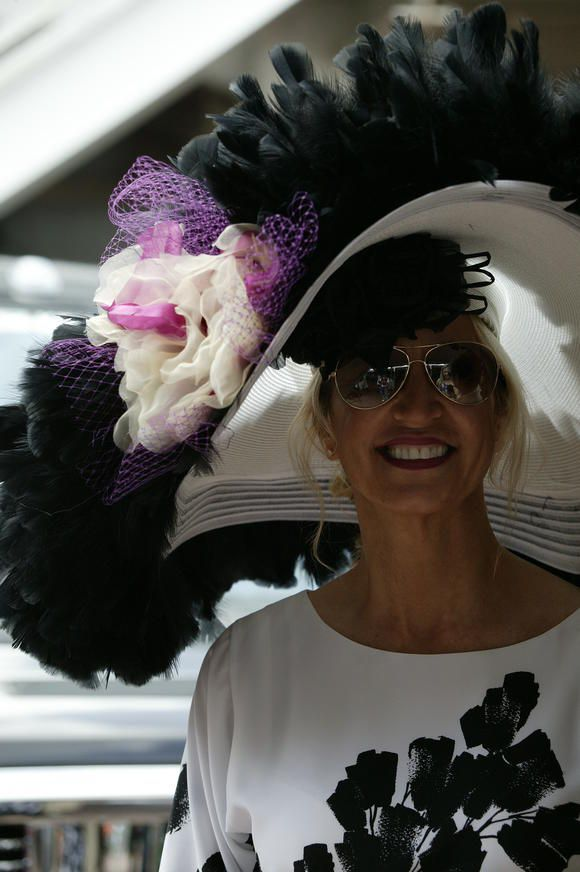 Hat tip: the bolder the better! Pair your Kentucky Derby hat with a smile.