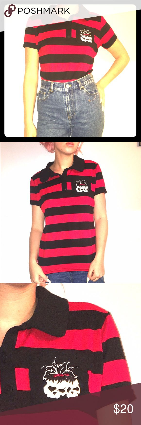 Women's stripe polo shirt with pocket detail Very stretchy stripe polo with pocket skull detail. Worn once. Great condition. Smoke free home! Tops Button Down Shirts