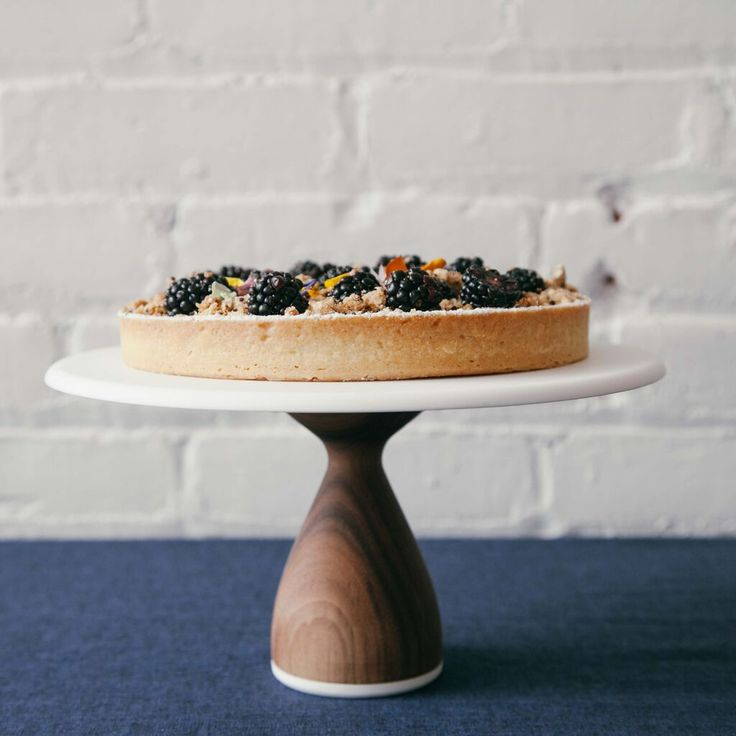 Walnut and corian cake stands by An Heirloom with a lovely tart by Duchess.