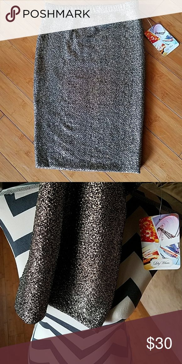 Gold and black skirt Brand new. Second picture shows the color better. Midi skin tight skirt. Thick material. Lily White Skirts Midi