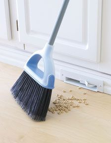 "Automatic vacuum ""dustpan"" built into cabinets. Such a great idea!"