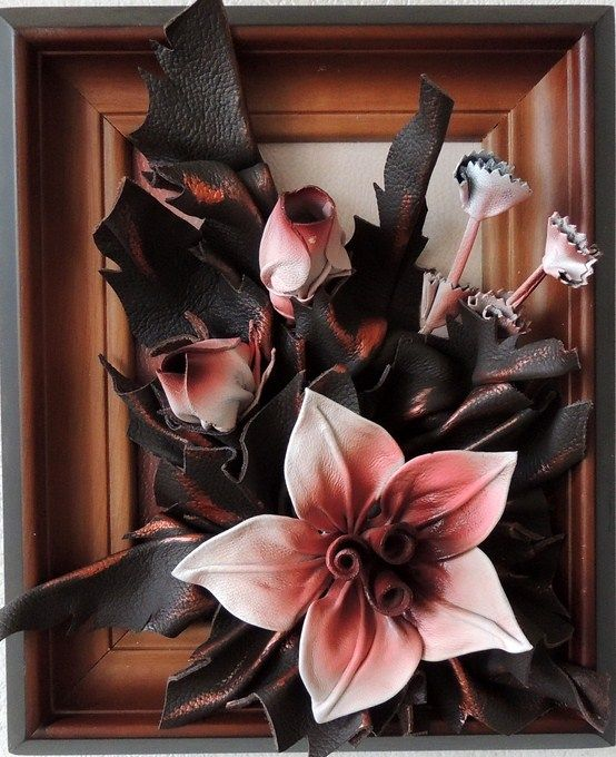 Lilies made from Leather  http://www.makmarketplace.com  Handcrafted Leather Wall Hanging Art - Sunflower and Poppy Size: 12in x 9in (28cm x 23cm) Frame: Rosewood Shaded Colors: White, Pink, Burgundy, Bronze, Copper Material: Genuine Leather   https://plus.google.com/communities/107298104499962573861 https://www.facebook.com/pages/MAK-Marketplace/331889076912354 http://www.pinterest.com/MAKMarketplace/