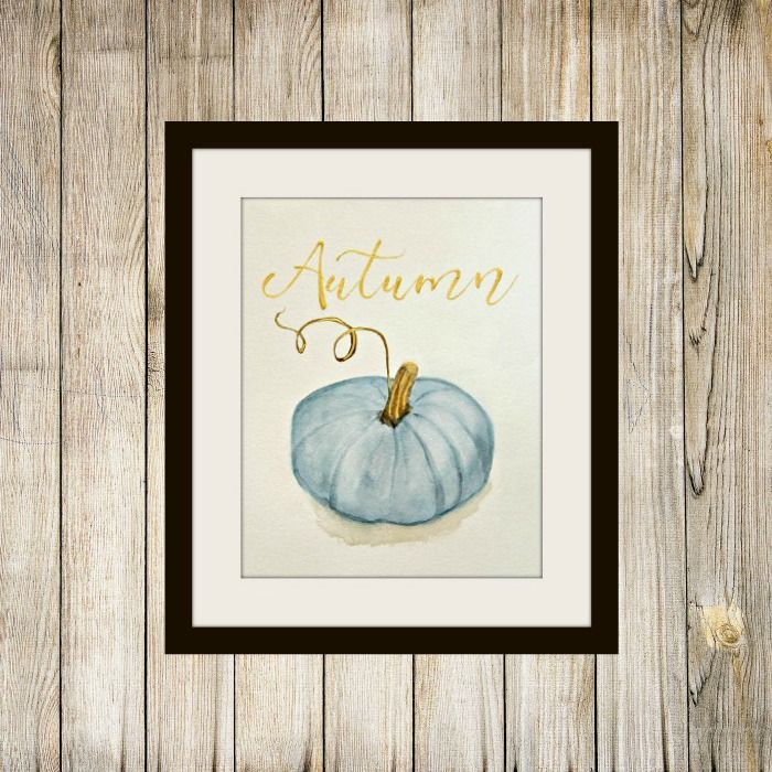 Free watercolor printable of a blue pumpkin with real gold acrylic lettering and accents.